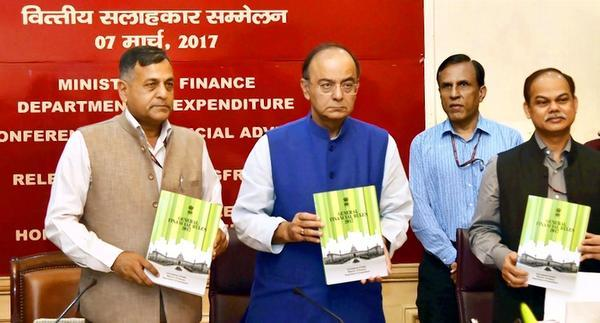 Finance Minister Arun Jaitley with Finance Secretary Ashok Lavasa (left) releasing the Revised General Financial Rules 2017 during the Conference of Financial Advisors at his office in New Delhi on Tuesday