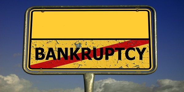 town sign bankruptcy insolvency illiquidity