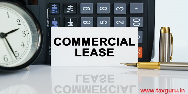 Clock, a pen, a calculator and a business card - COMMERCIAL LEASE