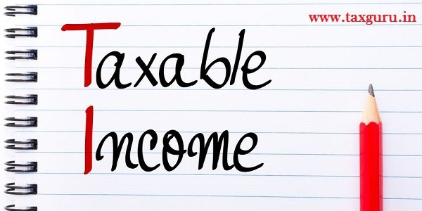 Taxable Income written on notebook page with red pencil on the right