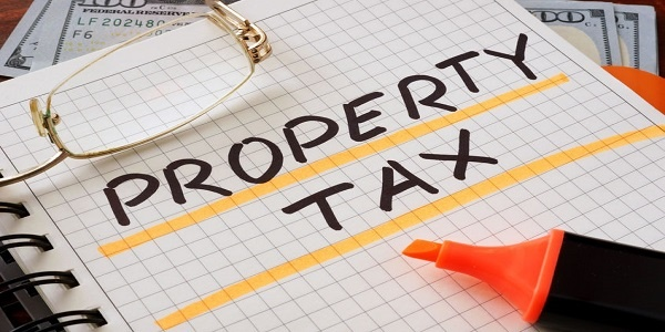 Notebook with property tax sign on a table. Business concep