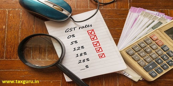 GST Rate - calculator on Indian currency notes, computer mouse