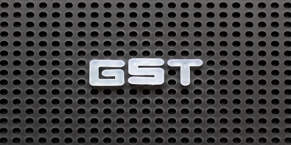 Black color pegboard with white letter in word GST (Abbreviation of Goods and Service Tax)