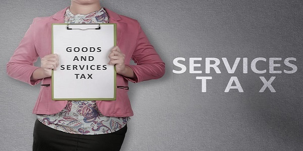 Business woman showing clipboard with Goods and services tax text. Goods and services tax concept