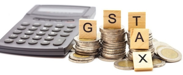 GST Goods and Services Tax word on stack coins