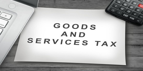 Goods and Service Tax sign on the paper. Goods and services tax concept