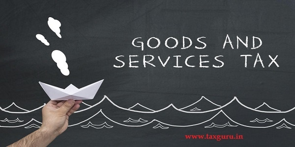 Finance, tax, business concept. hand holding sailing paper ship with text: goods and services tax GST