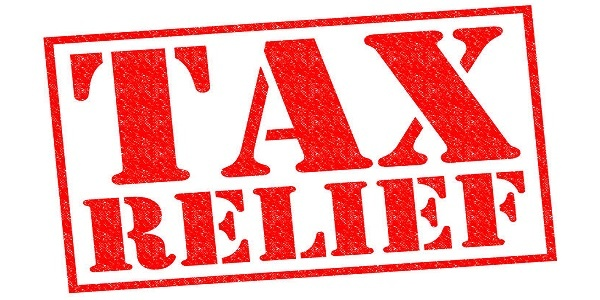 TAX RELIEF red Rubber Stamp over a white background.