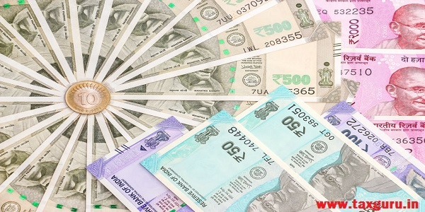 new indian 50, 100, 500 and 2000 rupees banknotes and 10 rupees coin.