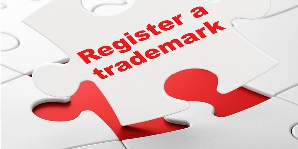 Register A Trademark on White puzzle pieces background