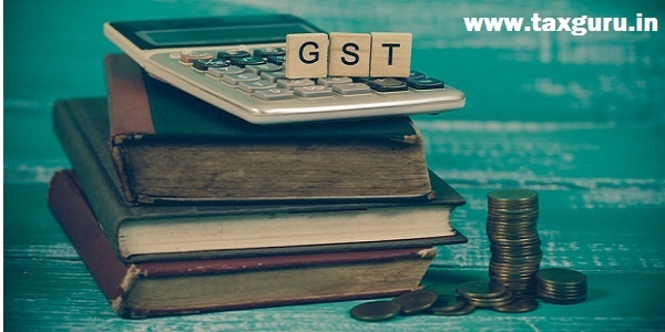 Word of GST on wooden alphabet blocks on calculator