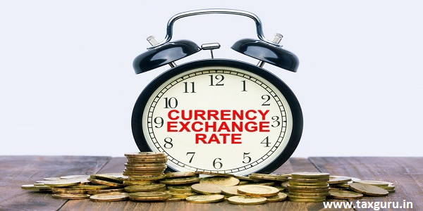 Written word Currency Exchange Rate on a clock with gold coins on top of a wooden table. Financial Wealth Concept.