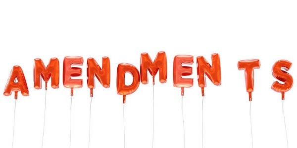 AMENDMENTS - word made from red foil balloons - 3D rendered.  Can be used for an online banner ad or a print postcard.