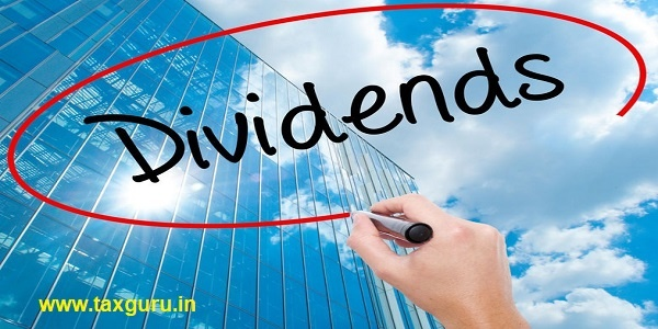 Man Hand writing Dividends with black marker on visual screen