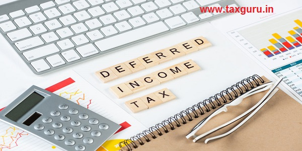 Deferred income tax concept with letters on cubes