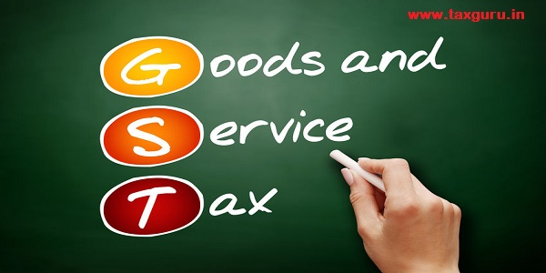 GST - Goods and Service Tax, acronym business concept on blackboard