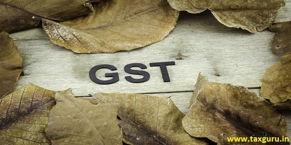 Word Goods and Services Tax - GST surrounded by dry leaves