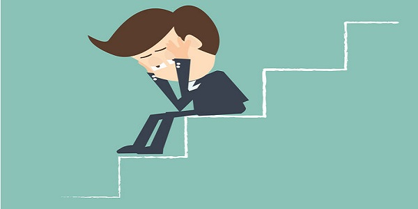 sad businessman on stairs - Economic downturn