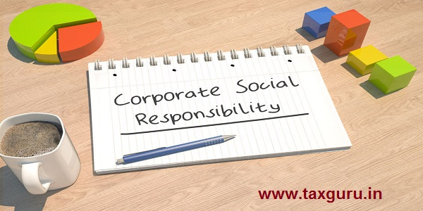 Corporate Social Responsibility - text concept with notebook, coffee mug, bar graph and pie chart on wooden background