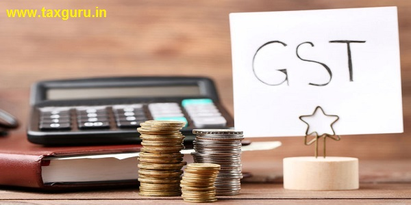 GST  Goods and Services TAx on paper with coins and calculator
