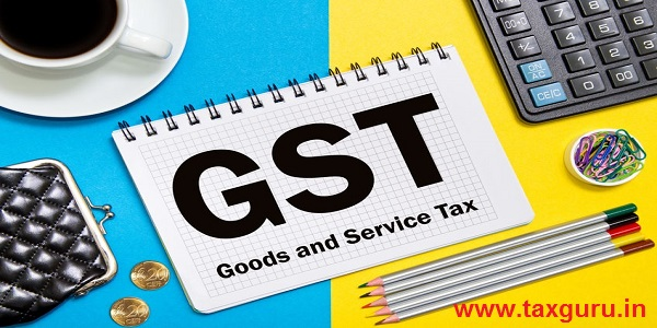 Goods and Service Tax notes in the notebook on the Desk in the office. Business concept GST tax