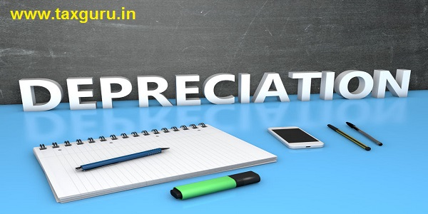 Depreciation - text concept with chalkboard, notebook, pens and mobile phone