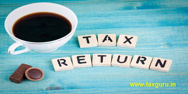 tax return - Coffee mug and wooden letters on wooden background
