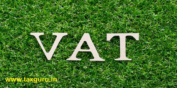 Wood alphabet in word VAT (Abberviation of Value added tax) on artificial green grass background