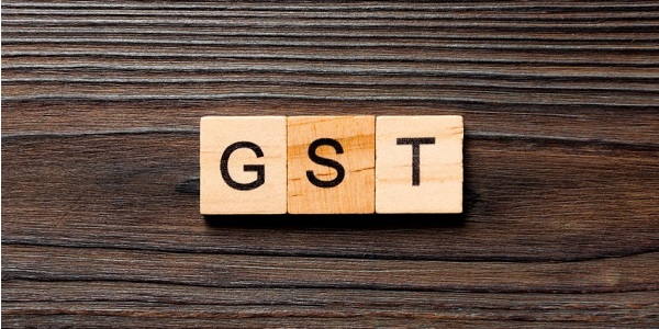 GST Goods and services tax word written on wood block