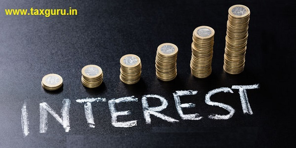 High Angle View Of Stacked Coin With Interest Concept Written On Blackboard