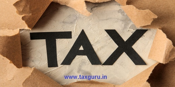 The word tax and torn paper. Taxes on the background of craft paper. top view