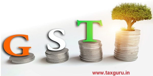 GST Goods & Services tax , Word on stack of coins
