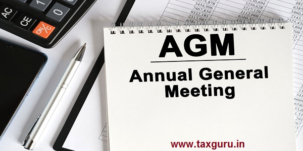On the table lies a smartphone, a calculator and a notebook with the inscription- AGM