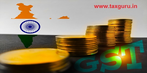 Goods services tax , word on paper with golden coins and Indian flag map