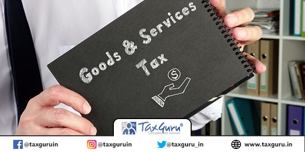 Financial concept about GST Goods & Services Tax with phrase on the sheet
