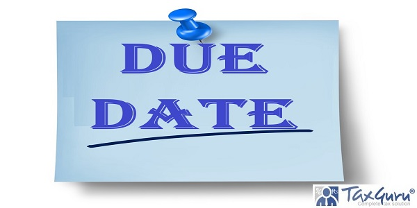 Due date office note with a blue thumb tack on pastel paper