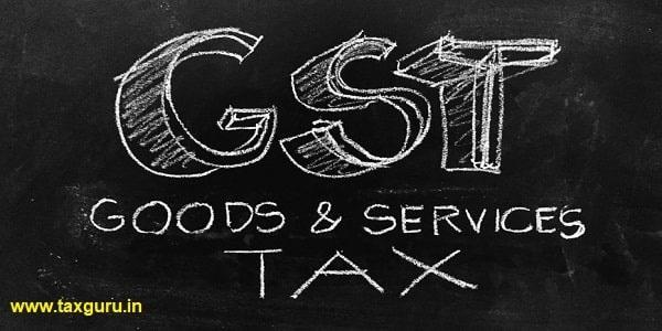 GST (Goods & Services Tax) Handwritten on Blackboard