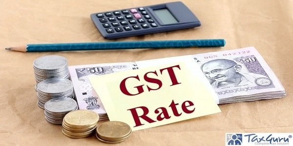 GST or goods and services tax Rate written on yellow note concept