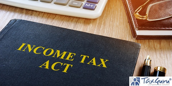 Income tax act and calculator on a desk