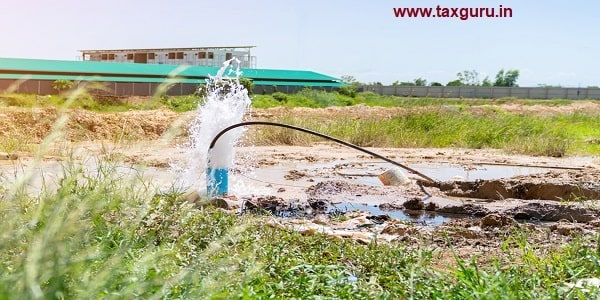 The water flowing artesian well after hole drilling machine installed for the water supply