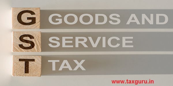 Acronym for Goods and Services Tax, in wooden alphabet letters with text on shadows