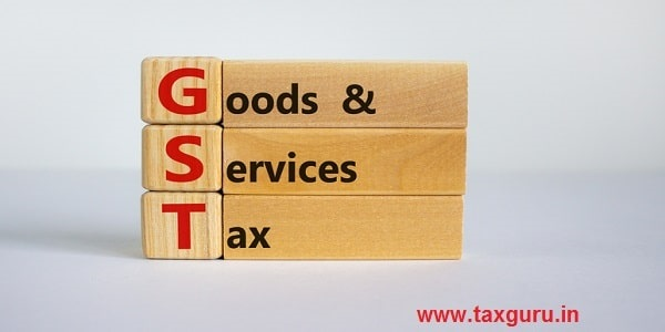Goods and services tax on wooden cubes and blocks on a beautiful white background