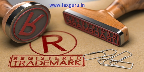 3D illustration of two rubber stamps with the text registered trademark and the symbol R over brown paper background