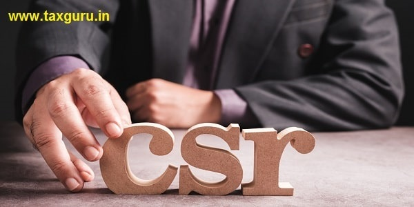 Closeup businessman place a wood alphabets on the desk as the abbreviation of CSR