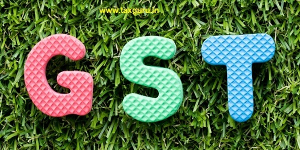 Color alphabet letter in word GST on artificial green grass background