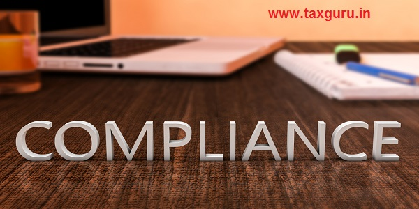 Compliance - letters on wooden desk with laptop computer and a notebook