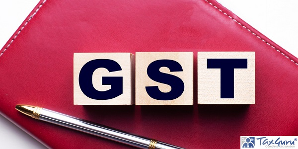 GST Goods and services tax made up of wooden cubes that stand on a burgundy notebook