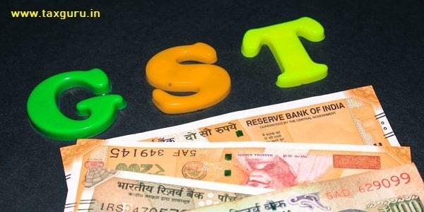 GST alphabet on money background