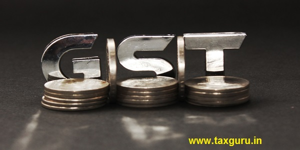 GST concept with stack of coins