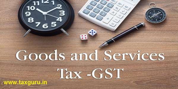 Goods and Services Tax (GST) words written on wooden table